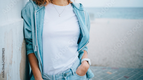 Young woman dressed in white plain t-shirt Wallpaper Mural