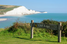 Cliff Edge Warning Sign At Seven Sisters Country Park Near Seaford East Sussex England United Kingdom UK