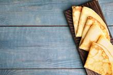 Fresh Thin Pancakes On Blue Wo...