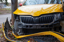 A Taxi Car Crashed Into A Pole. A Yellow Car Flew Off The Road. Car Accident. Dangerous Situation. The Car Frame Is Broken. Crumpled Hood And Broken Wheels. The Result Of Drunk Driving.