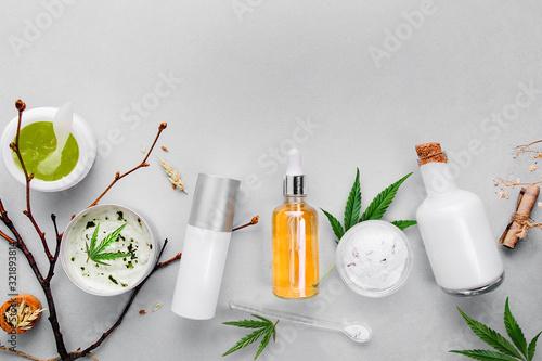 Fototapeta Cosmetics with cannabis CBD oil on light background. Concept natural skin care obraz