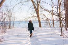 Winter Hike Woman Walking In S...
