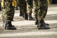 Closeup Shot Of Soldiers Wearing Uniforms Standing In Lines
