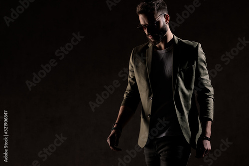 Cuadros en Lienzo cool unshaved young model walking in a fashion light