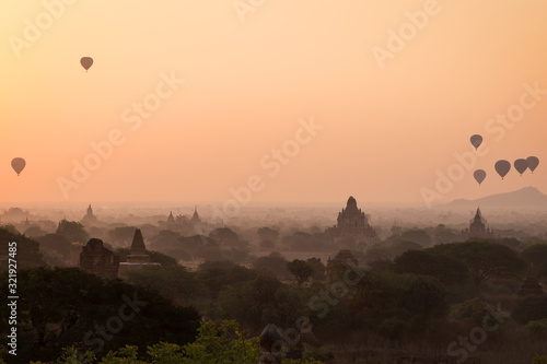 Beautiful view of hot-air balloons over temples and pagodas at the ancient plain of Bagan in Myanmar (Burma) at sunrise Canvas Print