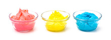 Bowls Of Brightly Colored Icing Mixed Withed With Gel Food Coloring