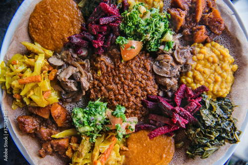 Large platter of Ethiopian food - 321929418