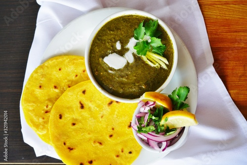 A dish of sarson ka saag spinach stew at an Indian restaurant Canvas Print