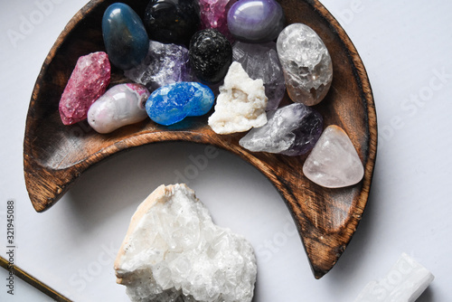 Cuadros en Lienzo stones in moon shaped dish with crystal quartz rock on white background