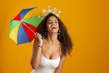 Young Curly Hair Woman Celebrating The Brazilian Carnival Party With Frevo Umbrella On Yellow.
