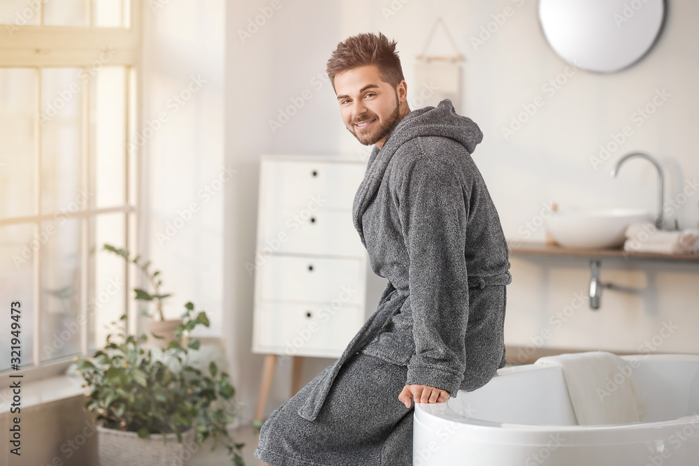 Fototapeta Morning of handsome young man in bathroom