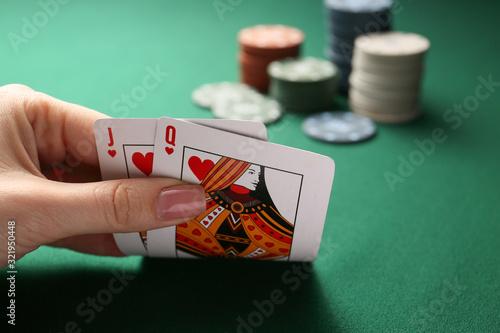 Zobacz obraz Woman playing poker in casino, closeup