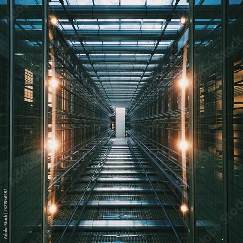 Obraz Vertical shot of an illuminated data center storage and network server room - fototapety do salonu