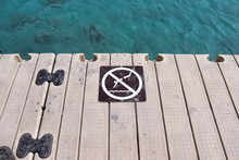 A No Diving Sign On The Edge O...