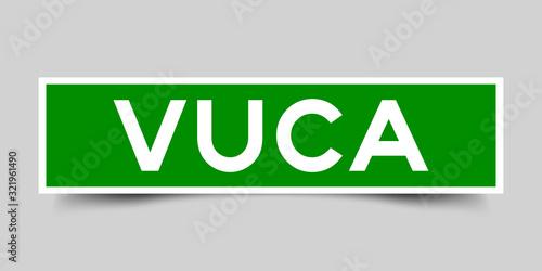 Photo Label square green sticker in word VUCA (abbreviation of Volatility, uncertainty