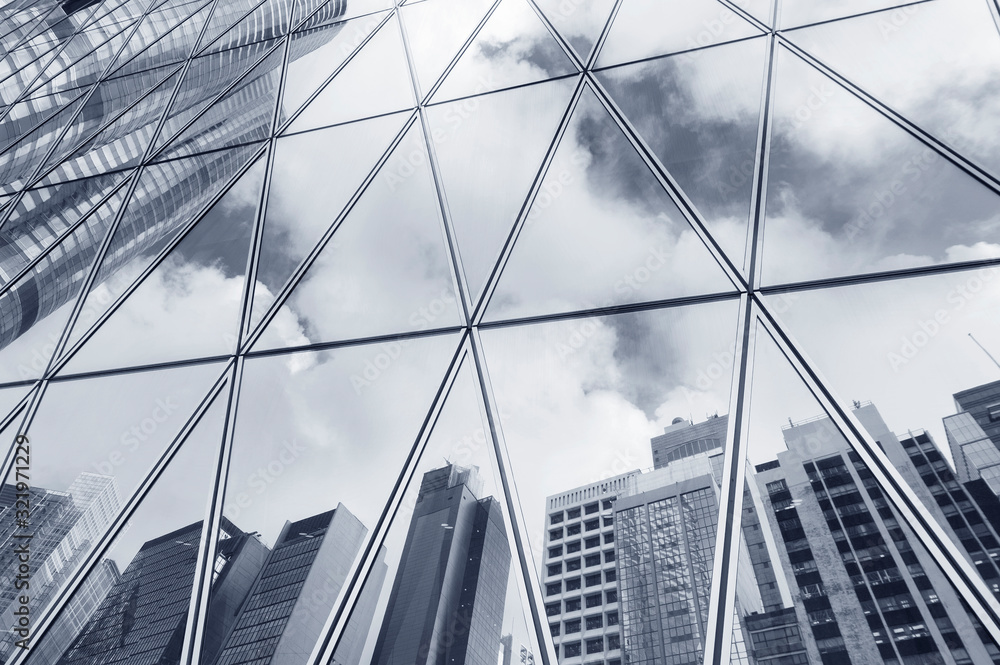 Fototapeta Reflection of urban skyline on modern office building