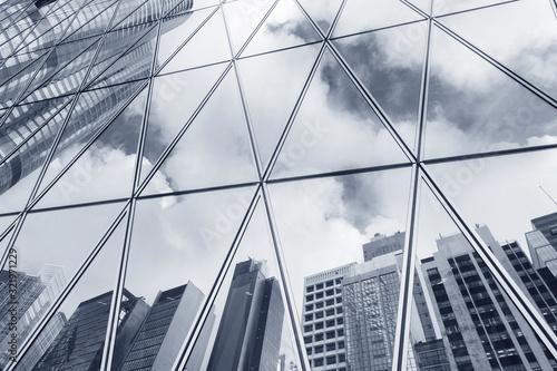 Fototapeta Reflection of urban skyline on modern office building obraz