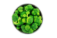 A Bowl Of Cooked Broccoli, Isolated On A White Background With A Clipping Path, Shot From The Top