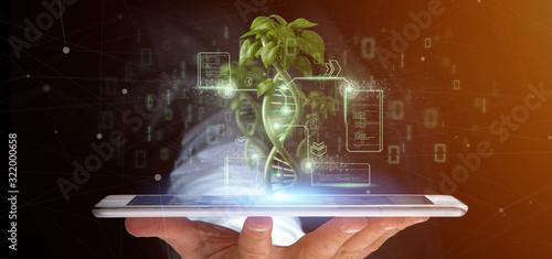 Fototapeta Businessman holding a DNA growing as a plant - 3d rendering obraz