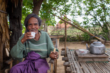 Burmese Man Relaxing Outside Home