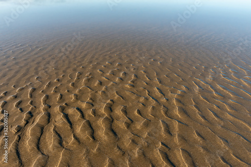 Stampa su Tela beach sand at low tide