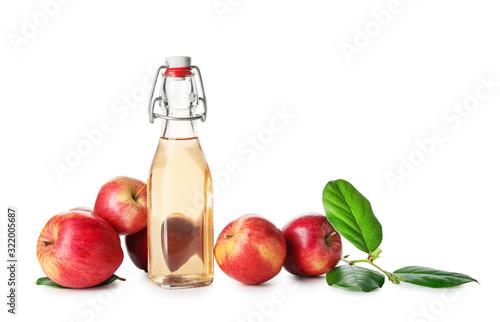 Fototapeta Bottle of apple cider vinegar on white background obraz