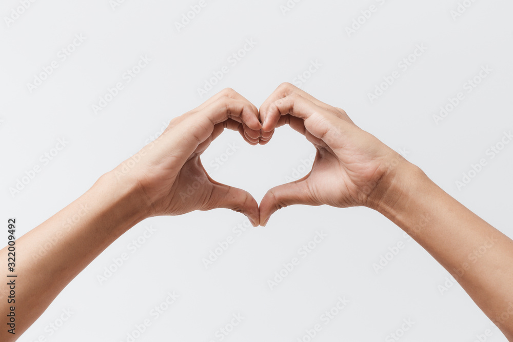 Fototapeta Man hands making a heart shape on a white isolated background