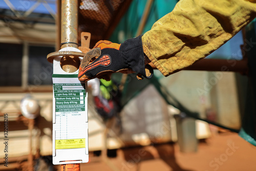 Wallpaper Mural Safety workplace site scaffolder supervisor wearing safety CS5 hand glove protec
