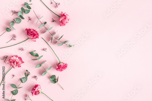 Flowers composition. Pink flowers and eucalyptus branches on pink background. Valentines day, mothers day, womens day concept. Flat lay, top view - 322023622