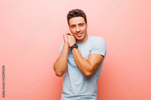 young arabian man feeling in love and looking cute, adorable and happy, smiling Canvas Print