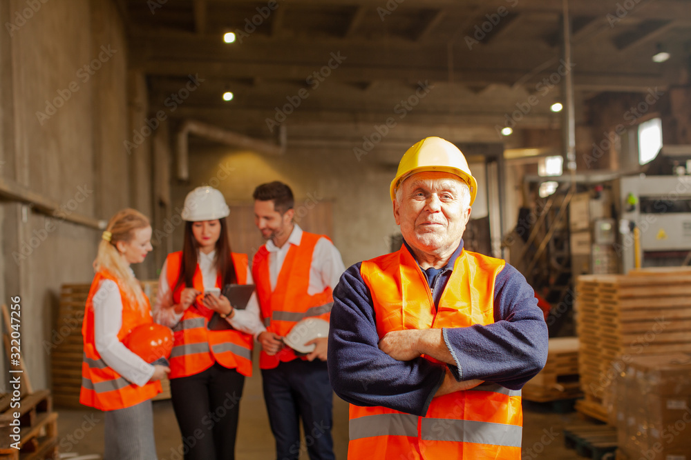 Fototapeta Team of business people in group with foreman standing in front