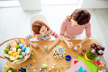 Top Above High Angle View Portrait Of Two Nice Attractive Creative Cheerful Girl Small Little Pre-teen Daughter Creating Decorative Eggs Handiwork Artwork On Sticks In White Light Interior Room House