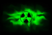 Radiation Sign On Background Of Polluted Green Fog.The Spread Radioactive Contamination Nuclear Weapons.  Dangerous Haze Poisoned. Vector Illustration