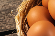 Eggs In The Hay Nest On Wooden...