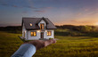 Concept of buying or building new home. Male hand showing, offering a new dream house at the empty field with copy space
