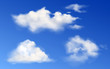 White clouds in blue sky. Vector realistic fluffy different shapes clouds in clean heaven in summer or spring day. Sunny clear weather