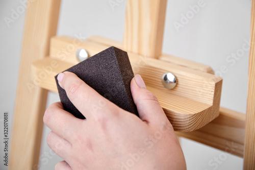 Photo Grinding sponge block in hand, abrasive tool