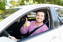 Man In New Car Showing Thumbs Up