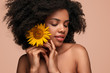 canvas print picture - Pretty black woman with yellow flower