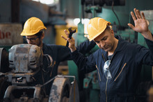 Shot Of Two Industrial Workers...