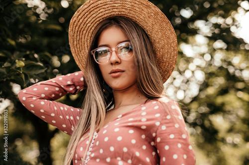 Fototapeta Stylish young woman in summer park obraz