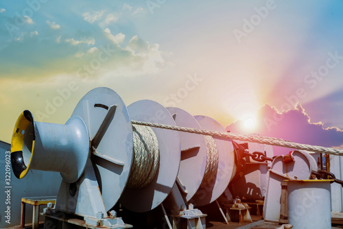 Mooring winch, Mooring windlass with white rope anchor in drum at Deck ship forward in shipyard retro filter tone Fotobehang