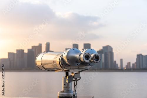 Fototapeta telescope with city skyline obraz