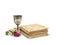 Matzo, Wine And Pink Flowers Apple Tree For Passover Celebration On White Background With Space For Text