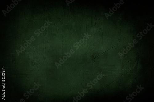 Fotografía dark green grunge background or texture with black vignette borders