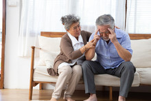 Asian Senior Retired Couple Holding Hands And Take Care Together At Home, Alzheimer Disease Or Suffering With Dementia Concept