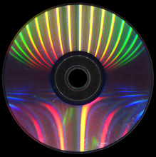 Scratched Dvd Disc On A Black ...