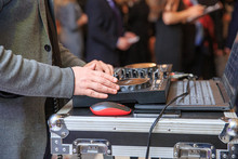 Hands Of A DJ Playing At An Aw...