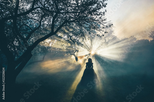 Woman in black in the foggy forest - gothic style. Fototapeta