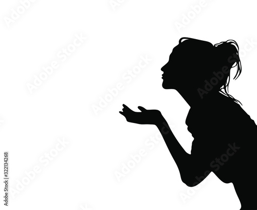 Fototapeta Pretty girl sending air kiss black silhouette isolated on white background.Woman profile stencil drawing.Beautiful lady vector illustration .Wall print.Vinyl decal.Valentine's day decoration element. obraz